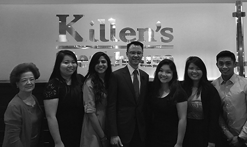 A black and white photo of Dr Gee and his staff
